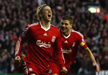 LIVERPOOL, UNITED KINGDOM - APRIL 08:  Fernando Torres of Liverpool celebrates scoring the opening goal with team mate Steven Gerrard (R) during the UEFA Champions League Quarter Final First Leg match between Liverpool and Chelsea at Anfield on April 8, 2