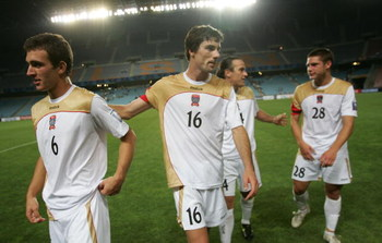 ULSAN, SOUTH KOREA - MAY 20:  Newcastle Jets team members leave the field after the AFC Champions League Group E match between the Ulsan Hyundai and the Newcastle Jets at Ulsan World Cup Stadium on May 20, 2009 in Ulsan, South Korea.  (Photo by Chung Sung