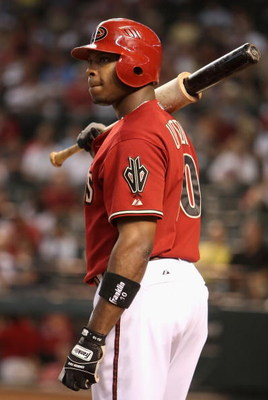 PHOENIX - JULY 26:  Justin Upton #10 of the Arizona Diamondbacks waits to bat during the major league baseball game against the Pittsburgh Pirates at Chase Field on July 26, 2009 in Phoenix, Arizona. The Diamondbacks defeated the Pirates 9-0.  (Photo by C