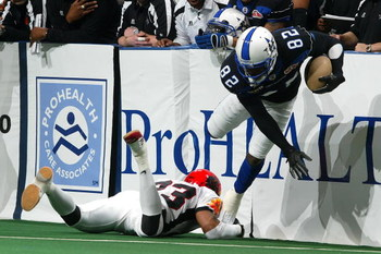 UNIONDALE, NY - MARCH 04:  Marcus Nash #82 of the Dallad Desperados eludes a tackle by Dahnel Singfield #23 of the New York Dragons during their Arena Football League game on March 4, 2007 at Nassau Coliseum in Uniondale, New York.  The Desperados defeate