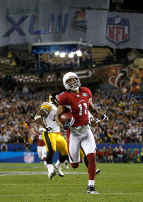 TAMPA, FL - FEBRUARY 01:  Wide receiver Larry Fitzgerald #11 of the Arizona Cardinals scores a 64-yard touchdown reception in the fourth quarter against the Pittsburgh Steelers during Super Bowl XLIII on February 1, 2009 at Raymond James Stadium in Tampa,