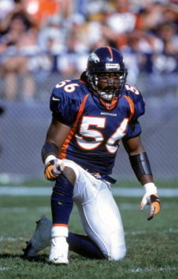 1 Oct 2000:  Al Wilson #56 of the Denver Bronocs kneels on the field during the game against the New England Patriots at the Mile High Stadium in Denver, Colorado. The Patriots defearted the Broncos 28-19..Mandatory Credit: Brian Bahr  /Allsport