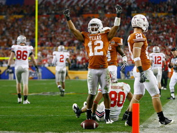 GLENDALE, AZ - JANUARY 05:  Cornerback Earl Thomas #12 of the Texas Longhorns celebrates a defensive stop against Brian Robiskie #80 of the Ohio State Buckeyes during the Tostitos Fiesta Bowl Game on January 5, 2009 at University of Phoenix Stadium in Gle