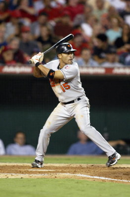 ANAHEIM, CA - AUGUST 11:  Infielder Jerry Hairston Jr. #15 of the Baltimore Orioles swings at an Anaheim Angels pitch during the game at Angel Stadium of Anaheim on August 11, 2004 in Anaheim, California. The Angels won 4-2. (Photo by Streeter Lecka/Getty