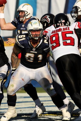 SAN DIEGO - NOVEMBER 30:  Center Nick Hardwick #61 of the San Diego Chargers blocks against defensive tackle Jonathan Babineaux #95 of the Atlanta Falcons on November 30, 2008 at Qualcomm Stadium in San Diego, California.  The Falcons won 22-16.  (Photo b