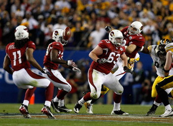 TAMPA, FL - FEBRUARY 01:  Kurt Warner #13 of the Arizona Cardinals gets hit by James Farrior #51 of the Pittsburgh Steelers as he gets rid of the ball during Super Bowl XLIII on February 1, 2009 at Raymond James Stadium in Tampa, Florida.  (Photo by Chris