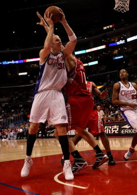 LOS ANGELES - NOVEMBER 7:  Chris Kaman #35 of the Los Angeles Clippers goes up for a shot against Yao Ming #11 of the Houston Rockets on November 7, 2008 at Staples Center in Los Angeles, California.  The Rockets won 92-83.  NOTE TO USER: User expressly a