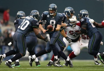 SEATTLE - NOVEMBER 16:  Quarterback Matt Hasselbeck #8 of the Seattle Seahawks looks to hand off the ball against the Arizona Cardinals at Qwest Field on November 16, 2008 in Seattle, Washington.  (Photo by Jonathan Ferrey/Getty Images)