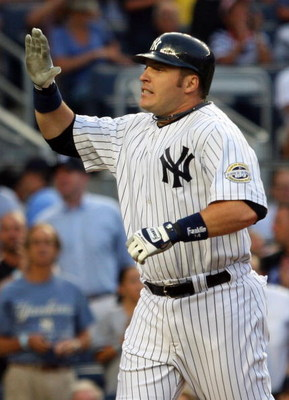 NEW YORK - JULY 20:  Eric Hinske #14 of the New York Yankees celebrates against the Baltimore Orioles on July 20, 2009 at Yankee Stadium in the Bronx borough of New York City.  (Photo by Jim McIsaac/Getty Images)