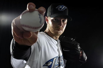 DUNEDIN, FL - FEBRUARY 22:  Pitcher Roy Halladay #32 of the Toronto Blue Jays poses for a photo on media day during spring training at the Bobboy Mattix Traing Center February 22, 2008 in Dunedin, Florida.  (Photo by Marc Serota/Getty Images)