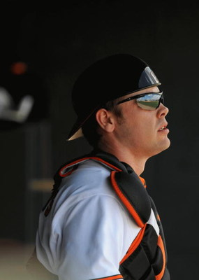 FORT LAUDERDALE, FL - FEBRUARY 26: Matt Wieters #15 of the Baltimore Orioles looks on from the dugout against the St. Louis Cardinals during a spring training game at Fort Lauderdale Stadium on February 26, 2009 in Fort Lauderdale, Florida. (Photo by Rob