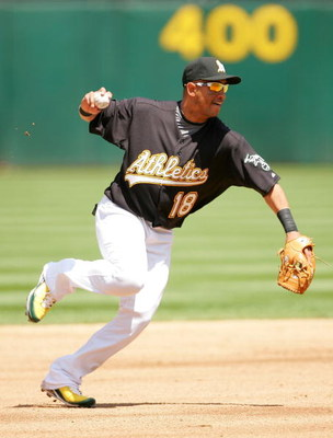 OAKLAND, CA - MAY 09:  Orlando Cabrera #18  of the Oakland Athletics throws to first base during their against the Toronto Blue Jays on May 9, 2009 at the Oakland Coliseum in Oakland, California.  (Photo by Ezra Shaw/Getty Images)