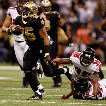 NEW ORLEANS - DECEMBER 07:  Reggie Bush #25 of the New Orleans Saints avoids a tackle by Lawyer Milloy #36 of the Atlanta Falcons on December 7, 2008 at the Superdome in New Orleans, Louisiana.  (Photo by Chris Graythen/Getty Images)