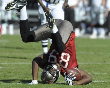 TAMPA, FL - DECEMBER 28: Wide receiver Antonio Bryant #89 of the Tampa Bay Buccaneers tumbles after a midfield catch against the Oakland Raiders at Raymond James Stadium on December 28, 2008 in Tampa, Florida.  (Photo by Al Messerschmidt/Getty Images)