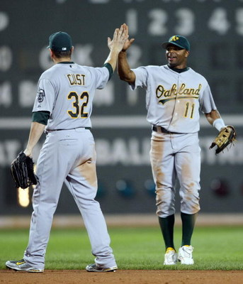 BOSTON - JULY 28:  Rajai Davis #11 of the Oakland Athletics celebrates the win with Jack Cust #32 after defeated the Boston Red Sox 9-8 in 11 innings at Fenway Park July 28, 2009 in Boston, Massachusetts. (Photo by Elsa/Getty Images)