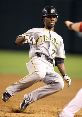 PHOENIX - JULY 23:  Andrew McCutchen #22 of the Pittsburgh Pirates slides back into first base during the major league baseball game against the Arizona Diamondbacks at Chase Field on July 23, 2009 in Phoenix, Arizona. The Diamondbacks defeated the Pirate