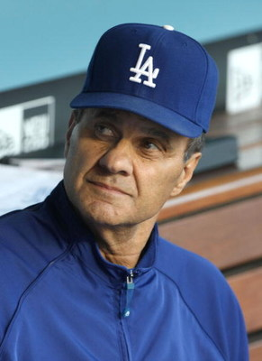 LOS ANGELES, CA - JULY 16:  Manager Joe Torre of the Los Angeles Dodgers looks on in the dugout during the game against the Houston Astros on July 16, 2009 at Dodger Stadium in Los Angeles, California.  (Photo by Stephen Dunn/Getty Images)