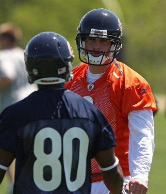 LAKE FOREST, IL - MAY 20: Jay Cutler #6 of the Chicago Bears gives instructions to teammate Earl Bennett #80 during an organized team activity (OTA) practice on May 20, 2009 at Halas Hall in Lake Forest, Illinois.  (Photo by Jonathan Daniel/Getty Images)