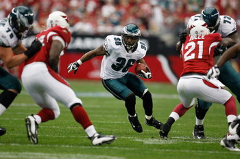 GLENDALE, AZ - JANUARY 18:  Running back Brian Westbrook #36 of the Philadelphia Eagles rushes against the Arizona Cardinals during the NFC championship game on January 18, 2009 at University of Phoenix Stadium in Glendale, Arizona.  (Photo by Chris Grayt