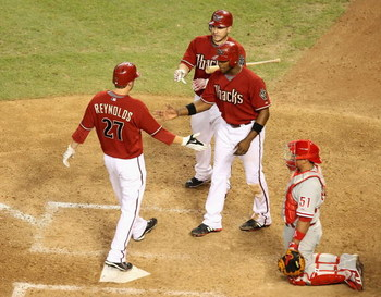 PHOENIX - JULY 28:  Mark Reynolds #27 of the Arizona Diamondbacks is congratulated by teammates Justin Upton #10 and Miguel Montero #26 after hitting a 2 run home run against the Philadelphia Phillies during the ninth inning of the major league baseball g