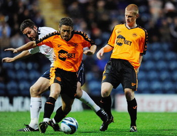 PRESTON, UNITED KINGDOM - JULY 28:  Preston's Jon Parkin challenges Michael Brown and Ben Watson during a pre season friendly match between Preston North End and Wigan Athletic at Deepdale on July 28, 2009 in Preston, United Kingdom.  (Photo by Michael Re