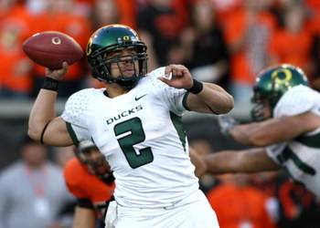 CORVALLIS, OR - NOVEMBER 29: Quarterback Jeremiah Masoli #2  of the Oregon Ducks throws a pass against the Oregon State Beavers at Reser Stadium on November 29, 2008 in Corvalis, Oregon.  (Photo by Jonathan Ferrey/Getty Images)