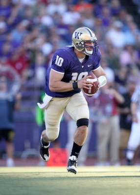 SEATTLE - SEPTEMBER 13:  Quarterback Jake Locker #10 of the Washington Huskies runs with the ball during the game against the Oklahoma Sooners on September 13, 2008 at Husky Stadium in Seattle, Washington. The Sooners defeated the Huskies 55-14.(Photo by