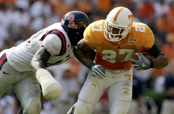 KNOXVILLE, TN - OCTOBER 01:  Patrick Willis #49 of the Mississippi Rebels wields a wounded hand as he tackles Arian Foster #27 of the Tennessee Volunteers as the Tennessee Volunteers defeated the Mississippi Rebels 27-10 at Neyland Stadium on October 1, 2