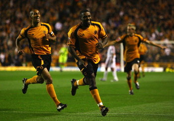 WOLVERHAMPTON, UNITED KINGDOM - SEPTEMBER 16:  Sylvan Ebanks-Blake (C) of Wolverhampton celebrates scoring the first goal during the Coca-Cola Championship match between Wolverhampton Wanderers and Crystal Palace at Molineux on September 16, 2008 in Wolve