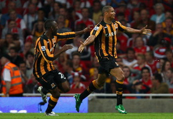 LONDON - SEPTEMBER 27:  Daniel Cousin of Hull City celebrates with teammates after scoring during the Barclays Premier League match between Arsenal and Hull City at the Emirates Stadium on September 27, 2008 in London, England.  (Photo by Mike Hewitt/Gett