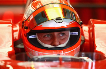 BARCELONA, SPAIN - FEBRUARY 25:  Michael Schumacher of Germany and Ferrari looks on from the pits during day one of the Formula One Testing at the Circuit de Catalunya on February 25, 2008 in Barcelona, Spain.  (Photo by Ryan Pierse/Getty Images)