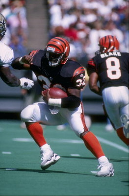 15 Sep 1996:  Running back Ki-Jana Carter of the Cincinnati Bengals carries the football during the Bengals 30-15 victory over the New Orleans Saints at Riverfront Stadium in Cincinnati, Ohio. Mandatory Credit: Andy Lyons  /Allsport