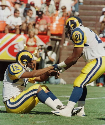 8 Sep 1996:  Running back Lawrence Phillips #21 of the St. Louis Rams picks up quarterback Tony Banks after being hit hard after the play during the Rams 34-0 loss to the San Francisco 49ers at 3Com Park in San Francisco, California. Mandatory Credit: Jed