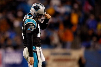 CHARLOTTE, NC - JANUARY 10:  Jake Delhomme #17 of the Carolina Panthers reacts at the end of the fourth quarter during the game against the Arizona Cardinals during the NFC Divisional Playoff Game on January 10, 2009 at Bank of America Stadium in Charlott