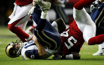 ATLANTA - DECEMBER 28:  Quarterback Marc Bulger #10 of the St. Louis Rams is sacked by linebacker Stephen Nicholas #54 of the Atlanta Falcons at Georgia Dome on December 28, 2008 in Atlanta, Georgia.  (Photo by Doug Benc/Getty Images)