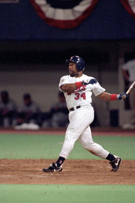 MINNEAPOLIS - OCTOBER 27:  Kirby Puckett #34 of the Minnesota Twins swings at a pitch during Game seven of the 1991 World Series against the Atlanta Braves at the Metrodome on October 27, 1991 in Minneapolis, Minnesota. The Twins defeated the Braves 1-0 i