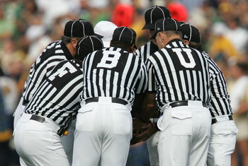 SOUTH BEND, IN - SEPTEMBER 16:  Referees hudle up prior to the start of the game between the Notre Dame Fighting Irish and the Michigan Wolverines September 16, 2006 at Notre Dame Stadium in South Bend, Indiana. Michigan won 47-21.  (Photo by Jonathan Dan