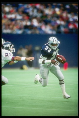 20 Sep 1987:  Running back Tony Dorsett of the Dallas Cowboys moves the ball during a game against the New York Giants at Giants Stadium in East Rutherford, New Jersey.  The Cowboys won the game, 16-14. Mandatory Credit: T. G. Higgins  /Allsport