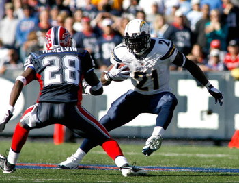 ORCHARD PARK, NY - OCTOBER 19: LaDanian Tomlinson #21 of the San Diego Chargers runs with pressure from Leodis McKelvin #28 of the Buffalo Bills  on October 19, 2008 at Ralph Wilson Stadium in Orchard Park, New York. Buffalo won 23-14.  (Photo by Rick Ste