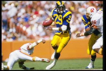5 Oct 1986:  Running back Eric Dickerson of the Los Angeles Rams moves the ball during a game against the Tampa Bay Buccaneers at Anaheim Stadium in Anaheim, California.  The Rams won the game in overtime, 26-20. Mandatory Credit: Mike Powell  /Allsport