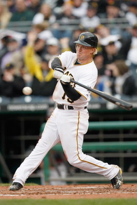 PITTSBURGH - APRIL 13:  Nate McLouth #13 of the Pittsburgh Pirates swings at the pitch during the Opening Day game against the Houston Astros at PNC Park on April 13, 2009 in Pittsburgh, Pennsylvania.  (Photo by: Gregory Shamus/Getty Images)