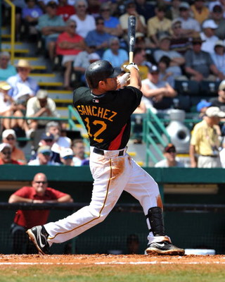 BRADENTON, FL - MARCH 8:  Infielder Freddy Sanchez #12 of the Pittsburgh Pirates hits a home run against the Houston Astros March 8, 2009 at McKechnie Field in Bradenton, Florida.  (Photo by Al Messerschmidt/Getty Images)
