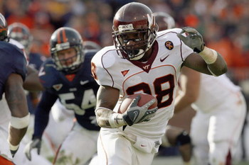 CHARLOTTESVILLE, VA - NOVEMBER 24: Tailback Branden Ore #28 of the Virginia Tech Hokies carries the ball  during game against the Virginia Cavaliers at Scott Stadium on November 24, 2007 in Charlottesville, Virginia. Virginia Tech defeated Virginia 33-21.