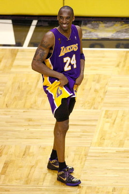 ORLANDO, FL - JUNE 14:  Kobe Bryant #24 of the Los Angeles Lakers smiles during the final moments of the Lakers' win over the Orlando Magic in Game Five of the 2009 NBA Finals on June 14, 2009 at Amway Arena in Orlando, Florida.  The Lakers won 99-86.  NO