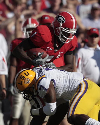 BATON ROUGE, LA - OCTOBER 25:  Mohamed Massaquoi #1 of the Georgia Bulldogs is stopped by Patrick Peterson #7 of the LSU Tigers during their football game at Tiger Stadium on October 25, 2008 in Baton Rouge, Louisiana.  (Photo by Dave Martin/Getty Images)