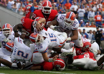 JACKSONVILLE, FL - NOVEMBER 01:  Quarterback Tim Tebow #15 of the Florida Gators dives in for a touchdown in the second quarter while taking on the Georgia Bulldogs at Jacksonville Municipal Stadium on November 1, 2008 in Jacksonville, Florida.  (Photo by