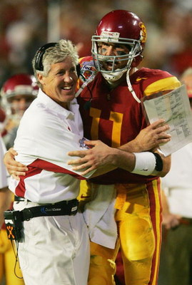 MIAMI - JANUARY 4:  Quarterback Matt Leinart #11 of the USC Trojans celebrates with head coach Pete Carroll in the fourth quarter against the Oklahoma Sooners during the FedEx Orange Bowl 2005 National Championship on January 4, 2005 at Pro Player Stadium
