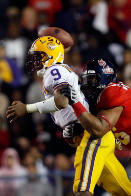 BATON ROUGE, LA - NOVEMBER 22:  Quarterback Jordan Jefferson #9 of the Louisiana State University Tigers is sacked by Lawon Scott #96 of the Ole Miss Rebels on November 22, 2008 at Tiger Stadium in Baton Rouge, Louisiana.  The Rebels defeated the Tigers 3
