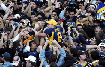 BERKELEY, CA - NOVEMBER 20:  Aaron Rodgers #8 of the California Golden Bears celebrates with fans after defeating the Stanford Cardinals on November 20, 2004 at Memorial Stadium in Berkeley, California.  (Photo by Jed Jacobsohn/Getty Images)