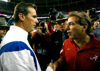 ATLANTA - DECEMBER 06:  Head coach Nick Saban of the Alabama Crimson Tide congratulates head coach Urban Meyer of the Florida Gators after the Gators 31-20 win in the SEC Championship on December 6, 2008 at the Georgia Dome in Atlanta, Georgia.  (Photo by